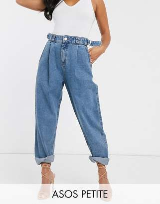 Asos DESIGN Petite Tapered boyfriend jeans with D-ring waist detail with curved seams in mid blue