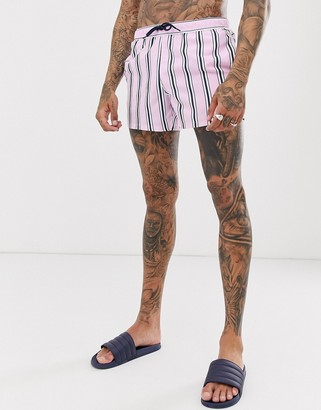 Asos Design DESIGN swim shorts with pink and navy stripe in short length