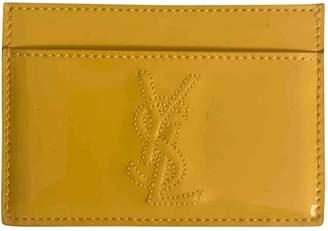 Saint Laurent Yellow Patent leather Purses, wallets & cases
