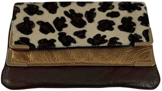 Michael Kors Brown Leather Clutch bags