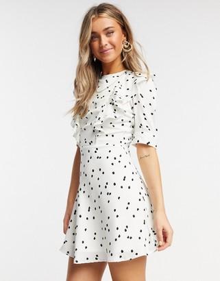 Influence frill bib mini dress in white polka dot