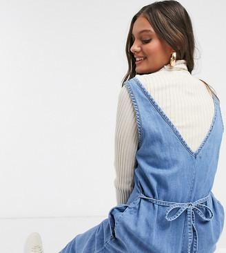 ASOS DESIGN Petite soft denim slouchy v-neck jumpsuit in blue