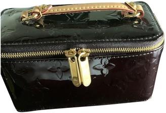 Louis Vuitton Purple Patent leather Travel bags