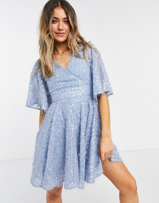 Forever U Forever Unique bat wing wrap sequin mini dress in blue