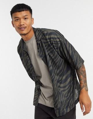 ASOS DESIGN oversized jersey shirt with all over zebra print in linen look