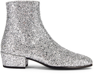 Saint Laurent Caleb Glitter Zip Boots in Silver | FWRD
