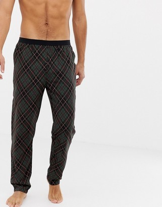 Asos Design DESIGN woven straight pyjama bottoms in argyle check with bright orange highlights-Green