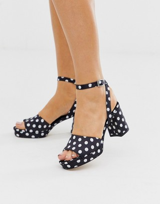 ASOS DESIGN Hockey platform heeled sandals in black and white polka dot