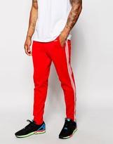 Adidas Originals Beckenbauer Skinny Joggers With Stirrups Ab7765 - Red