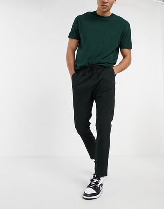 ASOS DESIGN skinny chinos with elastic waist in black