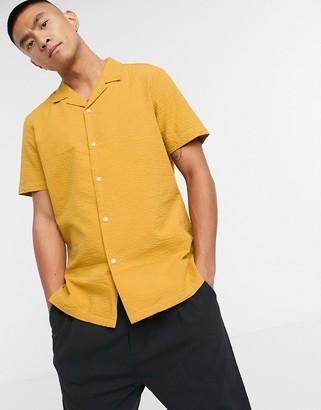 ASOS DESIGN regular fit revere collar seersucker shirt in pastel yellow