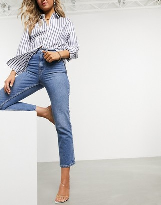 ASOS DESIGN high rise stretch 'slim' straight leg jeans in midwash