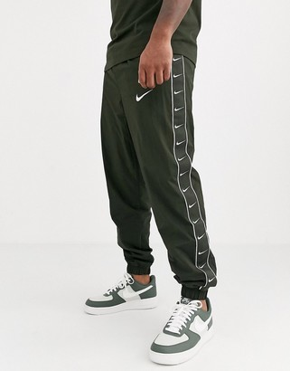 Nike Swoosh cuffed joggers with taping detail in khaki