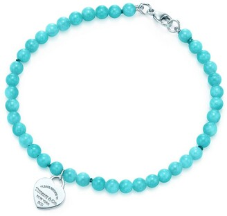 Tiffany & Co. Return to mini heart tag in silver on an amazonite bead bracelet