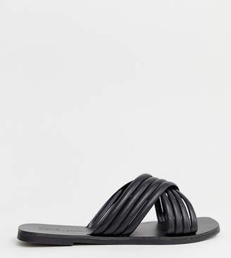 Asos Design DESIGN Wide Fit Falsetto cross strap flat sandals in black
