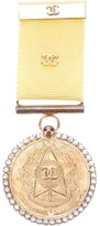 Chanel medal brooch