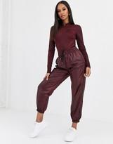 Nike burgundy snake Print Woven sweatpants