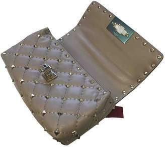 Valentino Rockstud spike Beige Leather Clutch bags