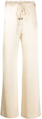 Nanushka Flax satin belted trousers