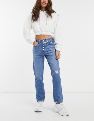 Levi's 501 crop jeans with knee abrasions in mid wash blue