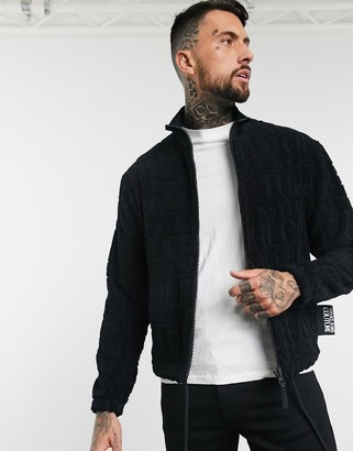 Versace all over logo jacquard towelling jacket in black