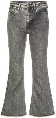 PT05 acid wash flared jeans