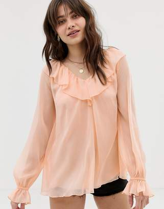 Asos Design DESIGN sheer long sleeve blouse with ruffle detail and cami-Pink