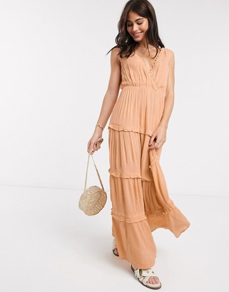 ASOS DESIGN sleeveless tiered crinkle maxi dress with lace inserts in peach