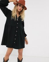 Asos Design DESIGN cotton slubby oversized shirt smock dress with horn buttons in black