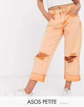 Asos DESIGN Petite low slung carpenter jeans with extreme rips in orange