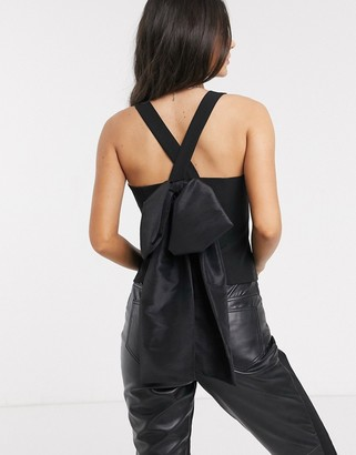 ASOS DESIGN cami top with extreme bow back detail in black