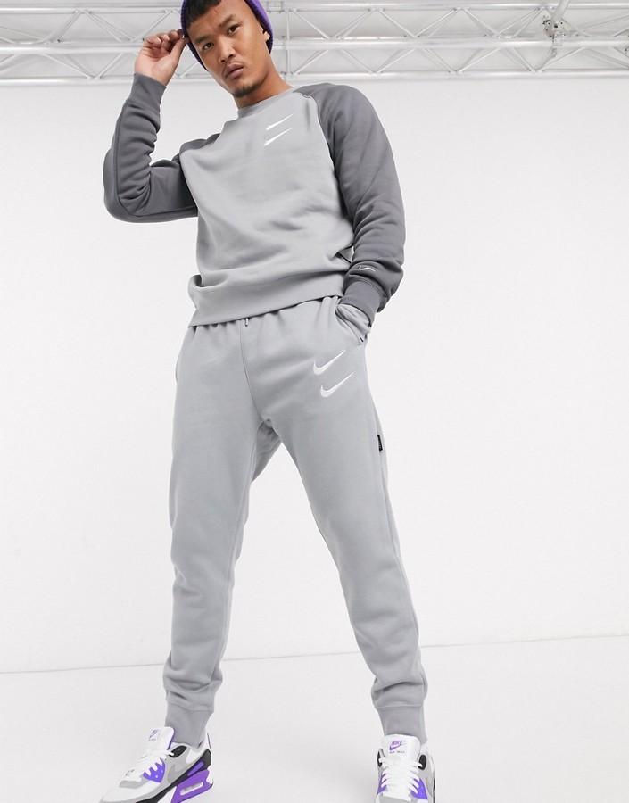 Mens Nike Swoosh Pants | Shop the world