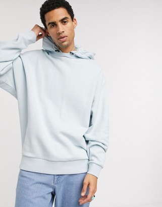Asos DESIGN oversized hoodie with nylon hood in light blue