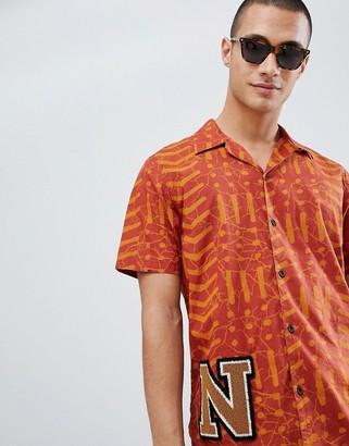 Nudie Jeans Brandon short sleeve organic cotton batik shirt in orange-White