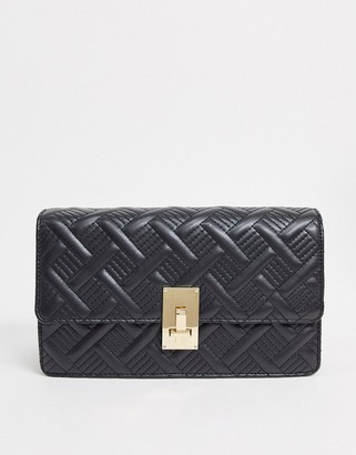 ASOS DESIGN quilted cross body bag with hardware detail in black