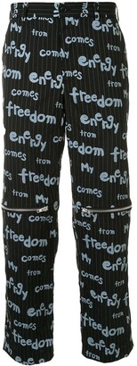 Comme des Garcons Slogan-Print Pinstriped Trousers