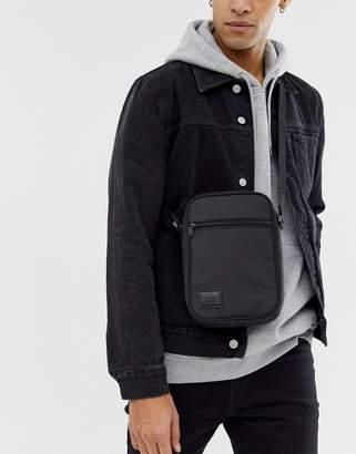 Asos Design DESIGN flight bag in black with patch