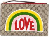 Gucci love embroidered GG Supreme clutch bag