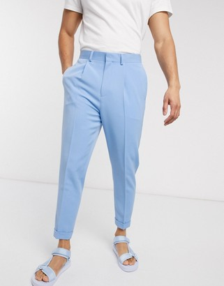 ASOS DESIGN tapered smart trouser in blue with pleat and turn up