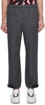Prada Rubberised logo cuff track pants