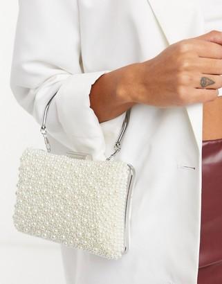 True Decadence pearl embellished bag with metal grab handle