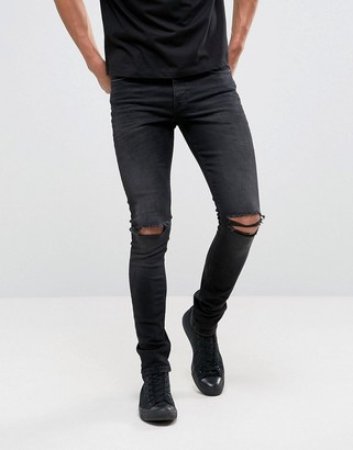 ASOS DESIGN super skinny 12.5oz jeans with knee rips in washed black