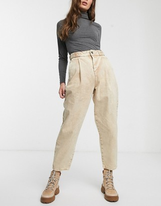 ASOS DESIGN Tapered boyfriend jeans with D-ring waist detail with curved seams in washed lemon