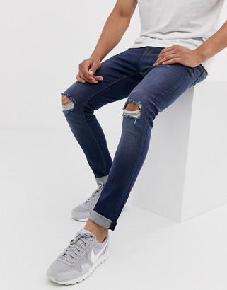 Asos Design DESIGN skinny jeans in dark wash with knee rips-Blue