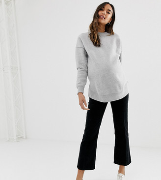 Asos DESIGN Maternity Egerton rigid cropped kick flare jeans in clean black cord with over the bump waistband
