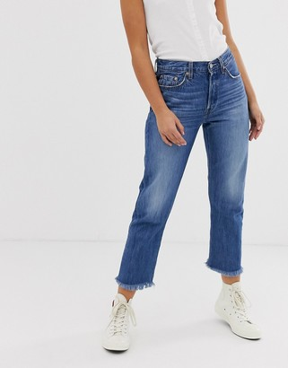 Levi's 501 crop jeans with raw hem in midwash blue