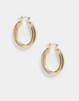 ASOS DESIGN hoop earrings in oval shape in gold tone