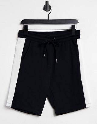 ASOS DESIGN jersey skinny shorts with side stripe in black