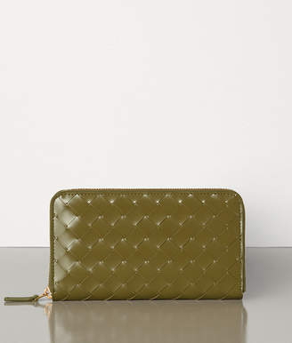 Bottega Veneta MEDIUM ZIP AROUND WALLET IN INTRECCIATO SPAZZOLATO CALF