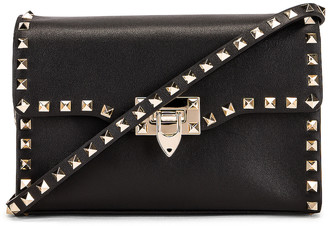 Valentino Rockstud Crossbody Bag in Black | FWRD